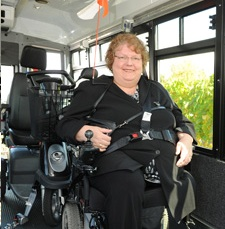 Photo of an adapted transportation client with seatbelt